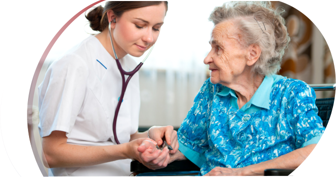 caregiver checking the pulse of elderly woman in a wheelchair